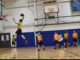910th Security Forces Defenders participate in an intramural basketball tournament